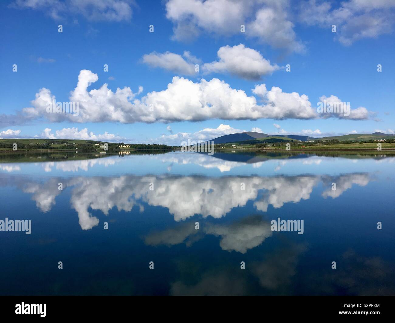 Perfect reflection on the water at Dingle, Ireland - Stock Image