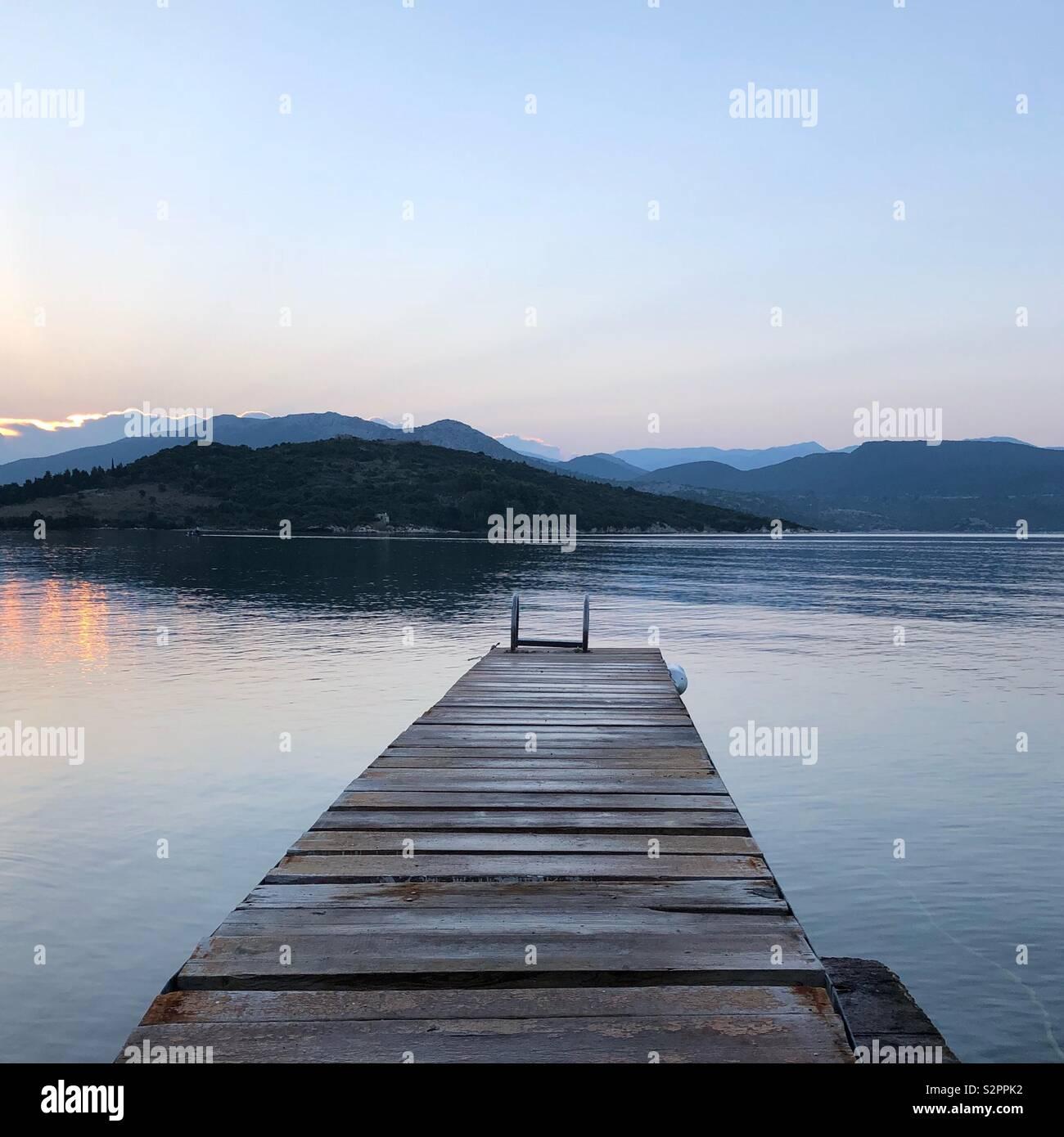 Greek sunrise with jetty - Stock Image