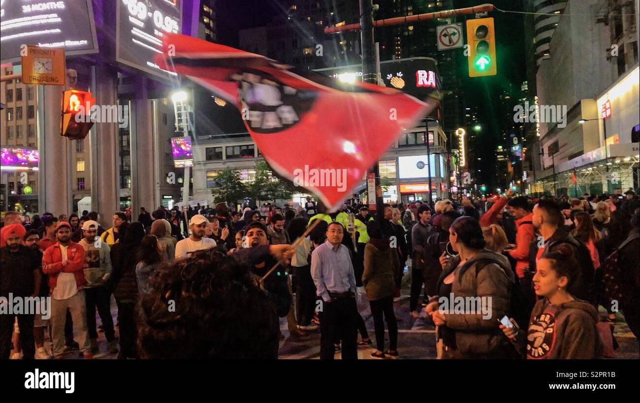 Raptors Fans gather on Yonge-Dundas Square in Toronto after the team's Game 5 loss to the Golden State Warriors - Stock Image