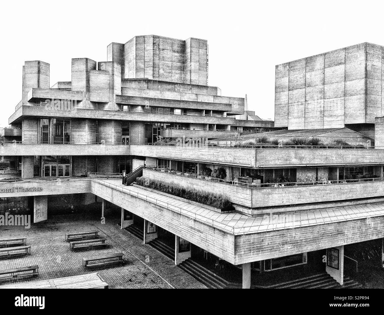 The Brutalist architecture of the National Theatre on the Southbank of the river Thames in London, England. - Stock Image