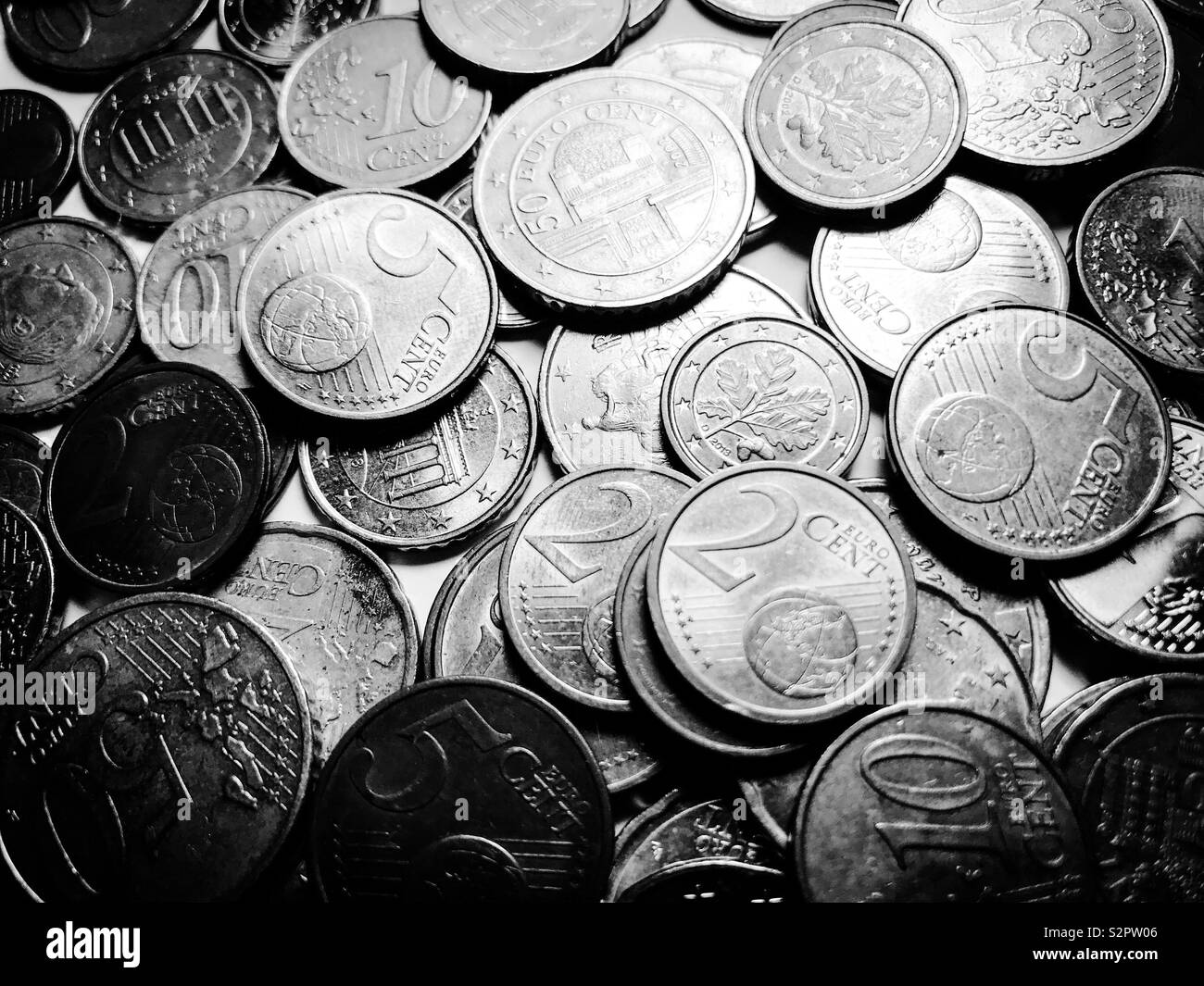 Pile of mixed euro coins - black and white - Stock Image