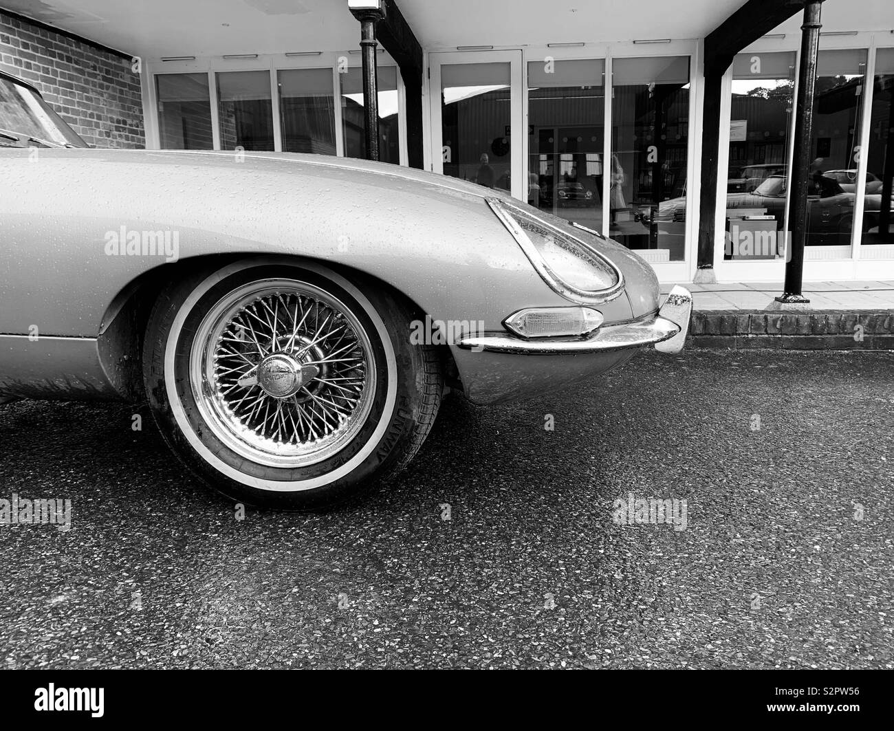 Classic sports car with wire wheels in ack and white - Stock Image