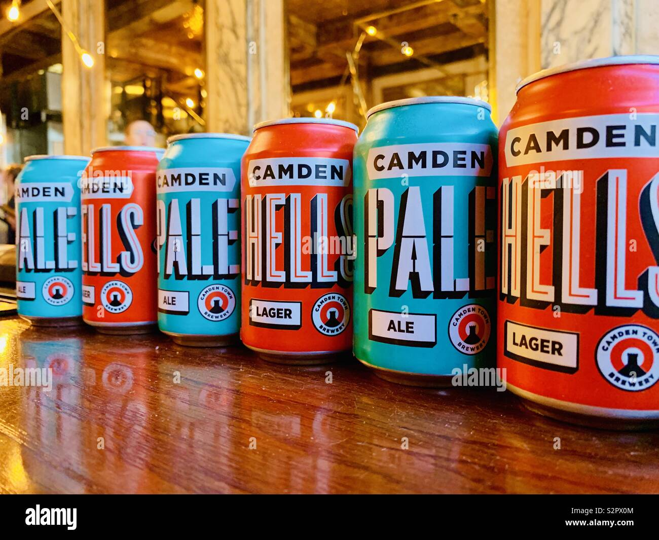 London,UK - 15th June 2019 - Cans of Camden Brewery lager and pale ale lined up in a burger restaurant on The Strand. - Stock Image