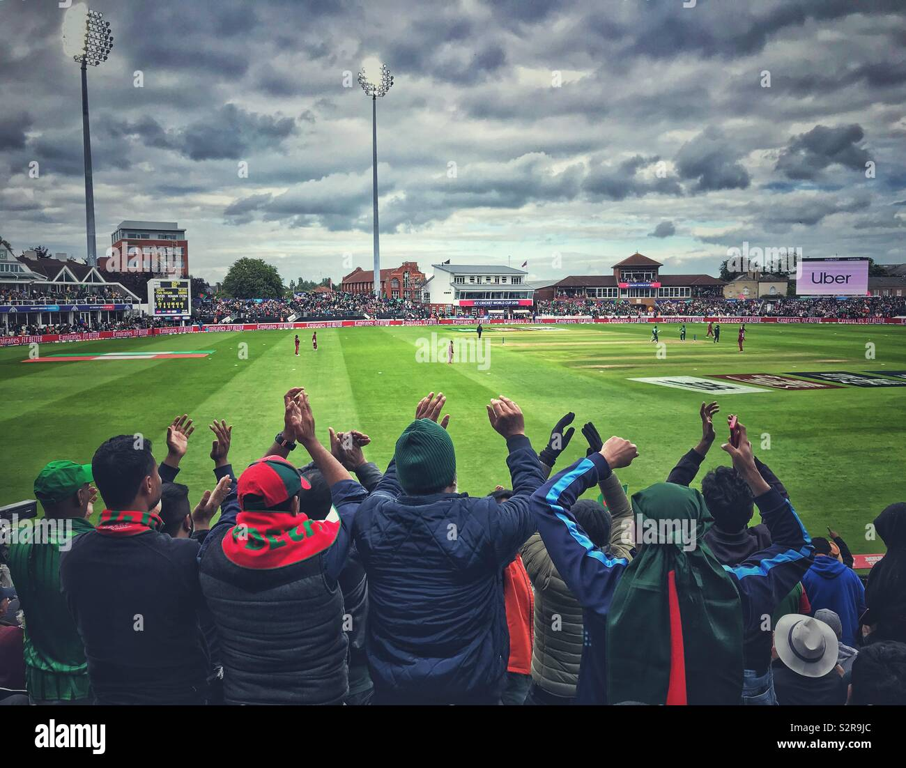 Bangladesh cricket fans enjoying themselves in the match against the West Indies at the Cricket World Cup at Taunton, Somerset - Stock Image
