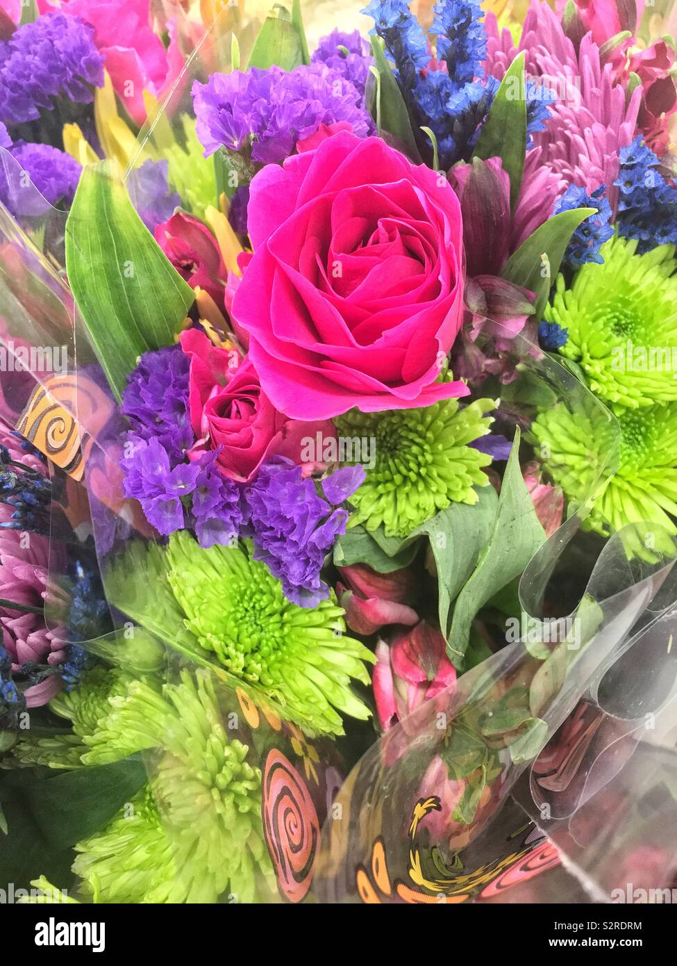 Bouquet of fresh colorful flowers with a pink rose. - Stock Image