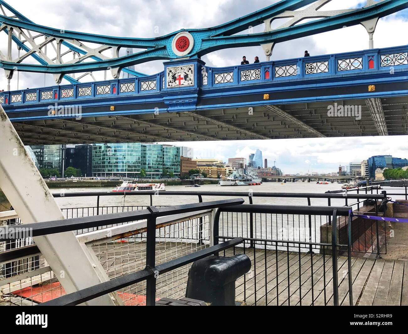 Tower Bridge and the river Thames viewed from St Katherine Docks, London, England. - Stock Image