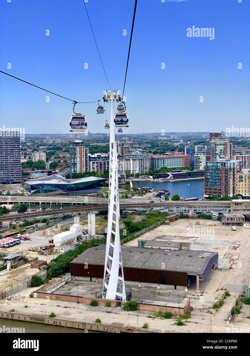 Greenwich, UK: 5 July 2019: The Emirates Air Line cable car between the Royal Victoria dock and the Greenwich peninsula. - Stock Image