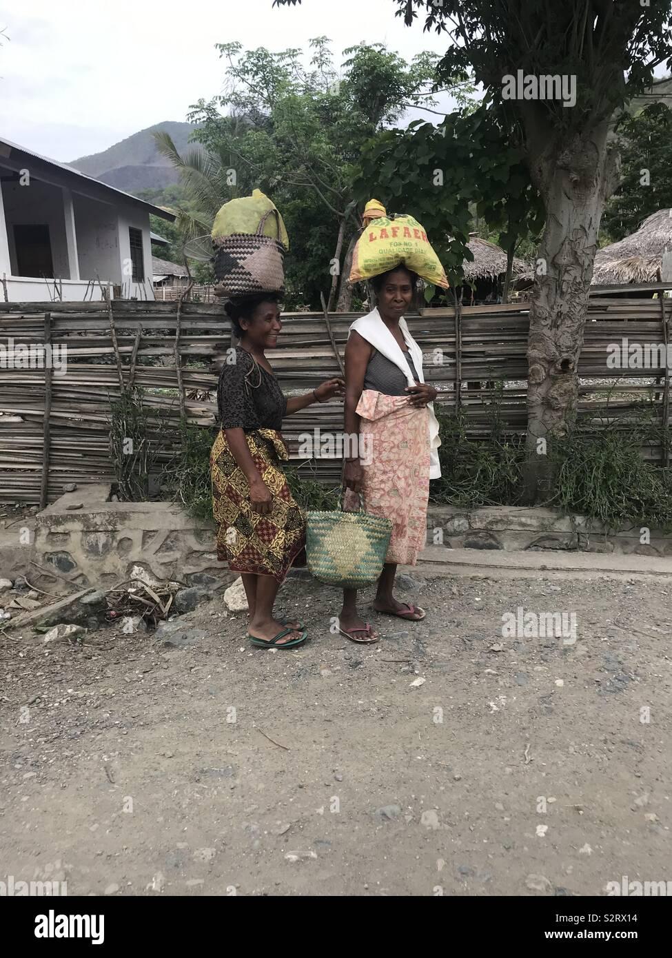 women carrying food to market, Timor Leste Stock Photo