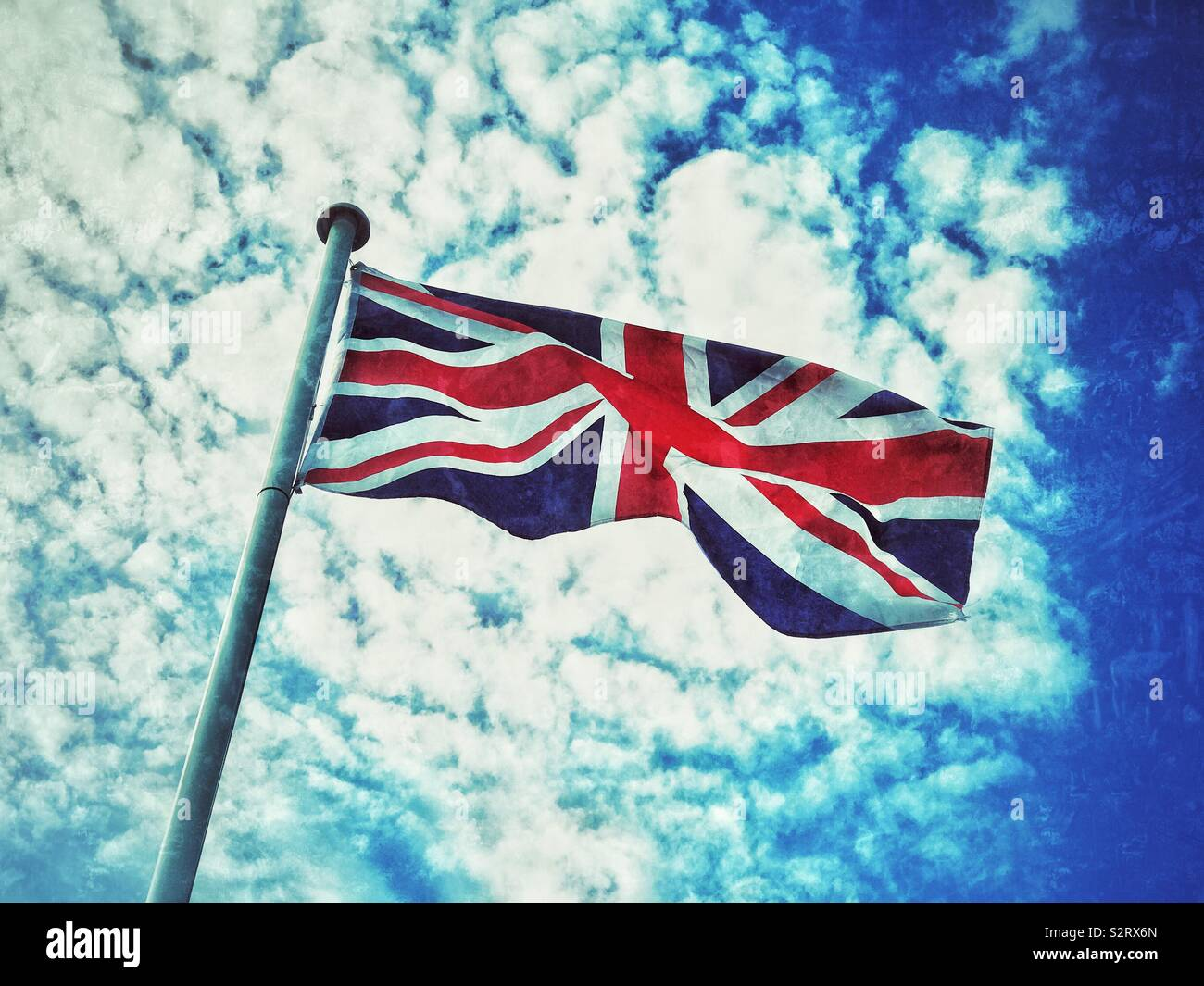 The Union Jack flag flies in the summer sunshine. The flag of The United Kingdom is sometimes referred to as The Union Flag. Photo Credit - © COLIN HOSKINS. - Stock Image