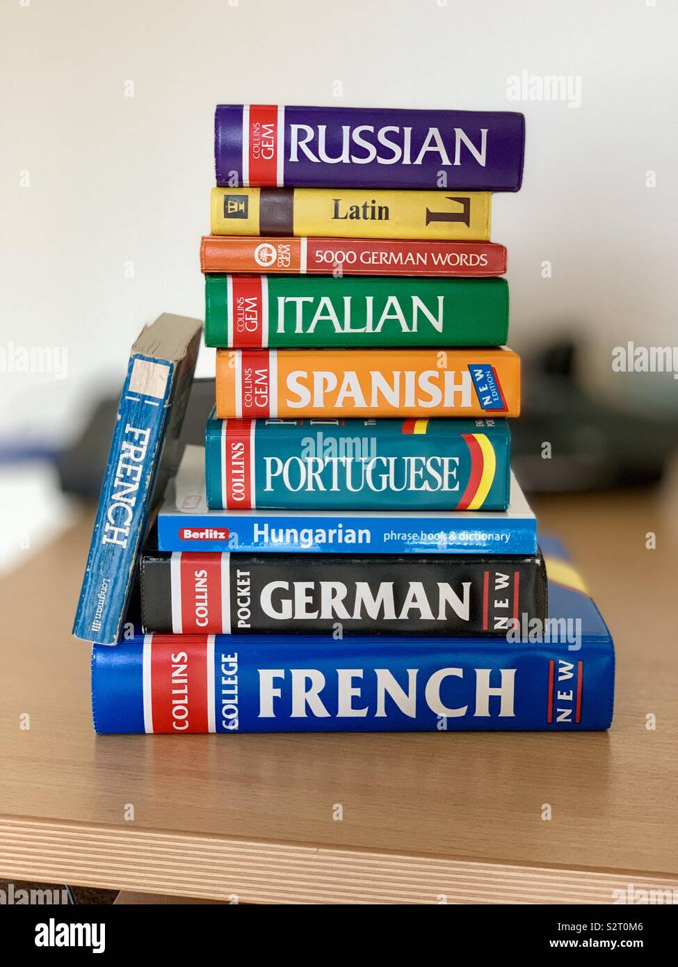 A stack of English to other language dictionaries. Stock Photo