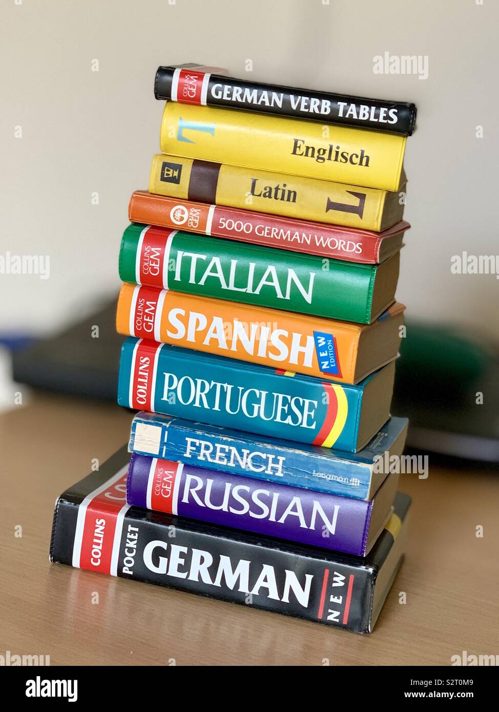A pile of English to other language dictionaries. Many languages. - Stock Image