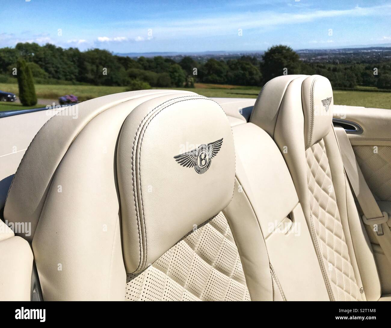 Bentley logo on the back of leather seats in a convertible - Stock Image