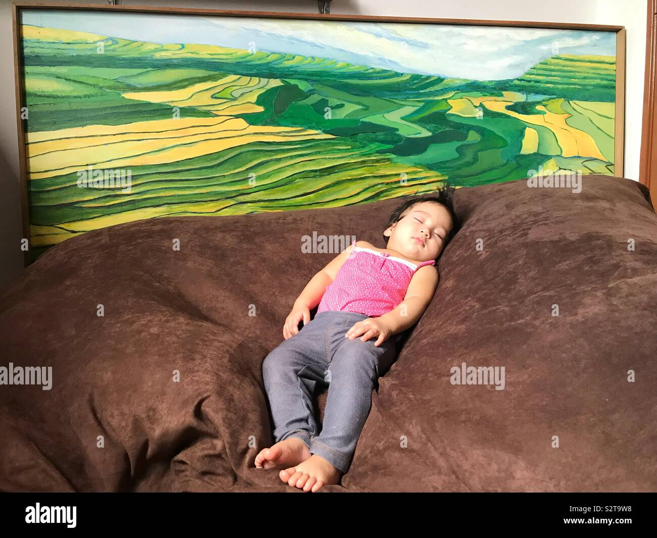 Magnificent Baby Sleeping On Bean Bag With Paddy Field Painting Stock Machost Co Dining Chair Design Ideas Machostcouk