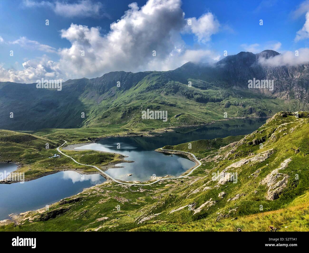 Llyn Llydaw, Snowdonia National Park, with the Miners track crossing it, August. Stock Photo