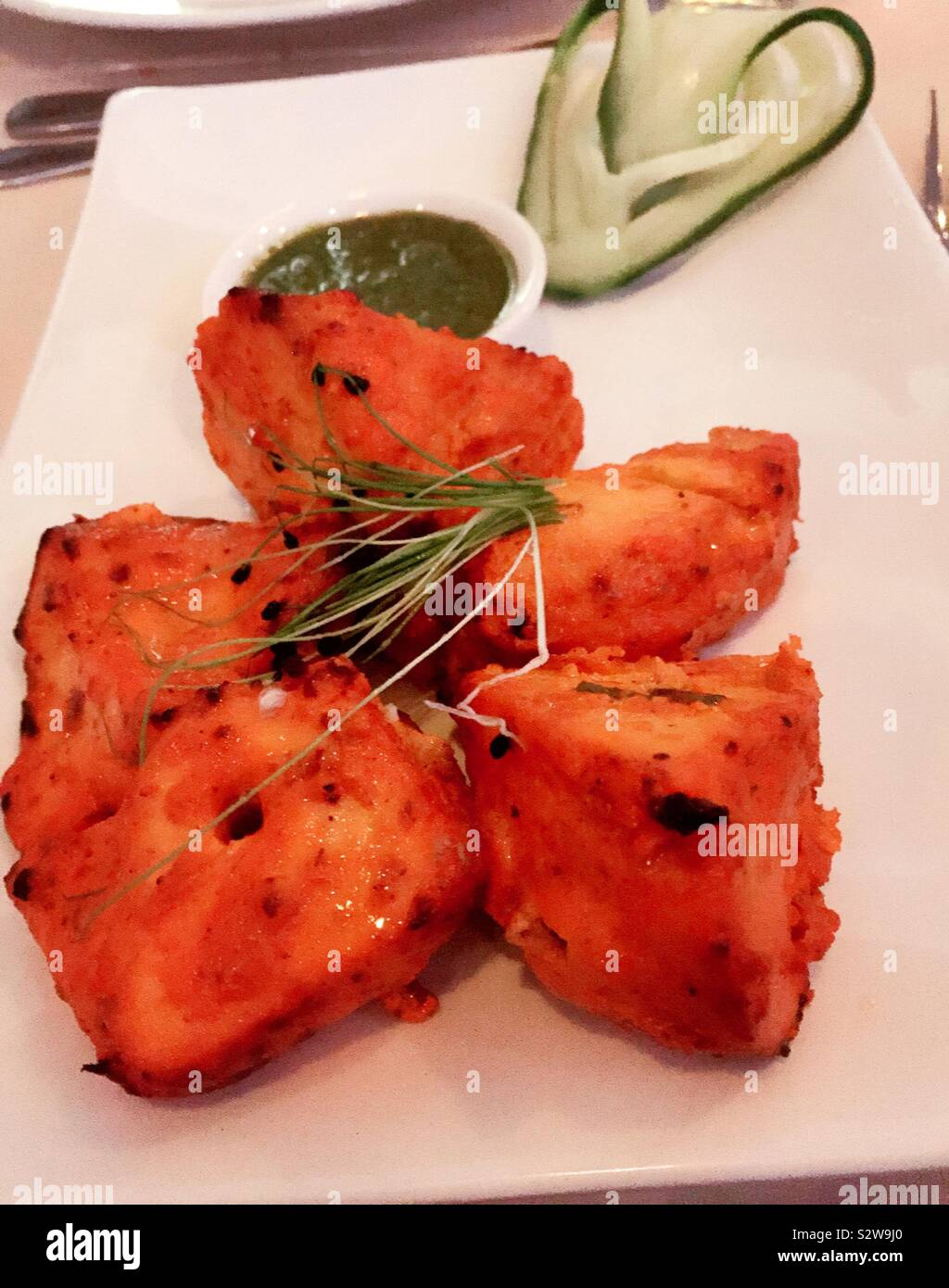 Close Up Of A Gourmet Entree Of Chicken Tikka At An Upscale
