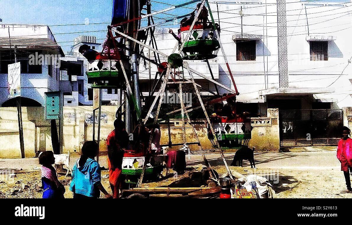 Spinning Wheel Or Little Tivoli In Varanasi The Kids Love It Stock Photo Alamy