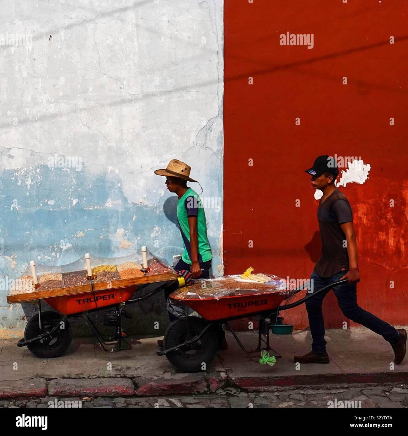 Traveling nut salesmen in Antigua, Guatemala Stock Photo