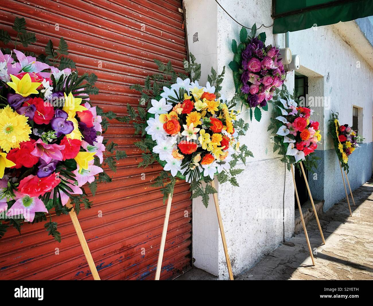 Floral Wreaths And Arrangements Are On Display For Purchase In Preparation For Dia De Los Muertos Stock Photo Alamy