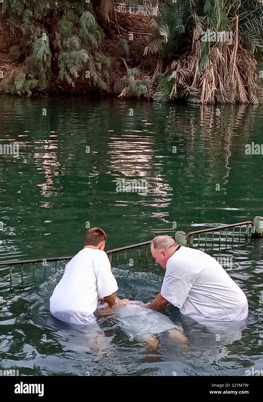 Baptism at the Jordan river in Israel. Stock Photo