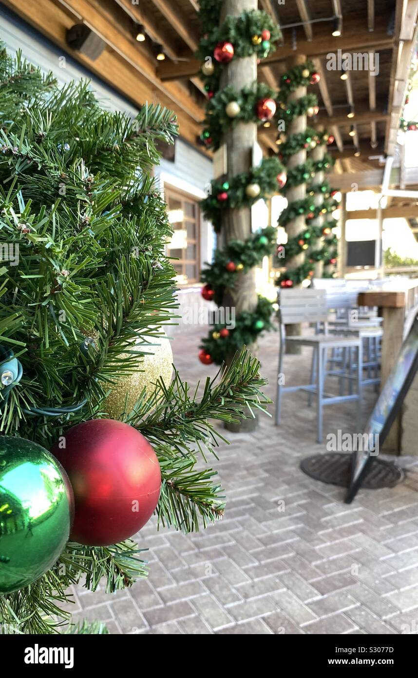 Outdoor Christmas decorations wrapped around poles Stock Photo