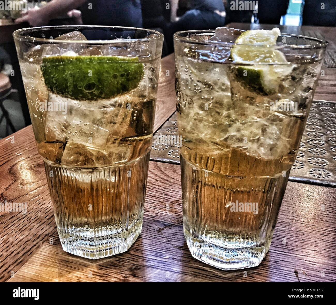 Two Glasses Of Whiskey With Ginger Ale And Lime Stock Photo