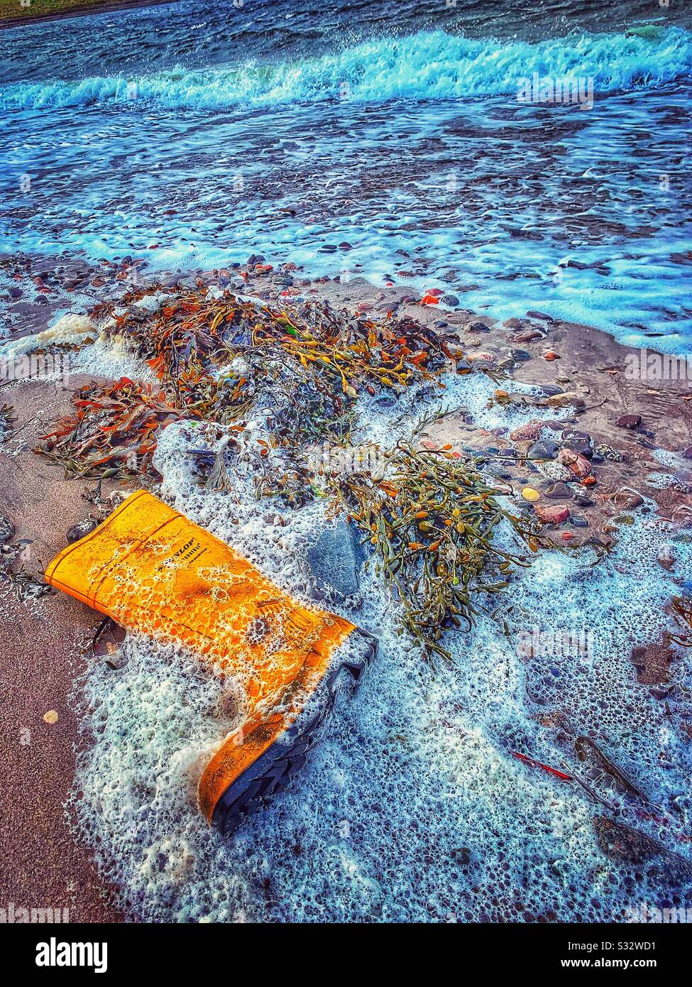 Washed up welly. Stock Photo