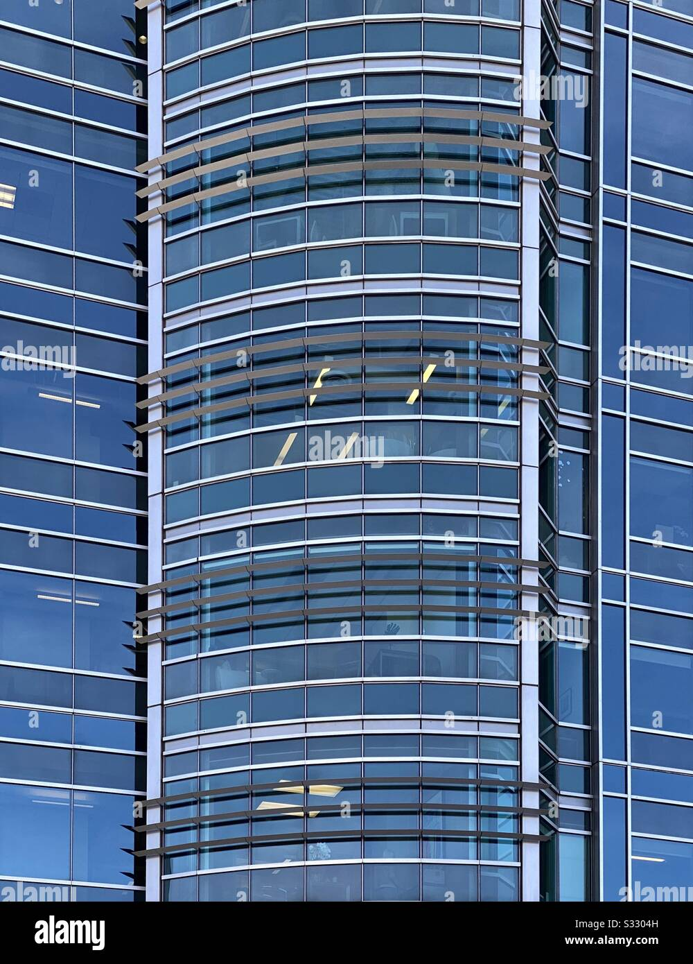 Abstract of large glass building with blue sky reflections Stock Photo