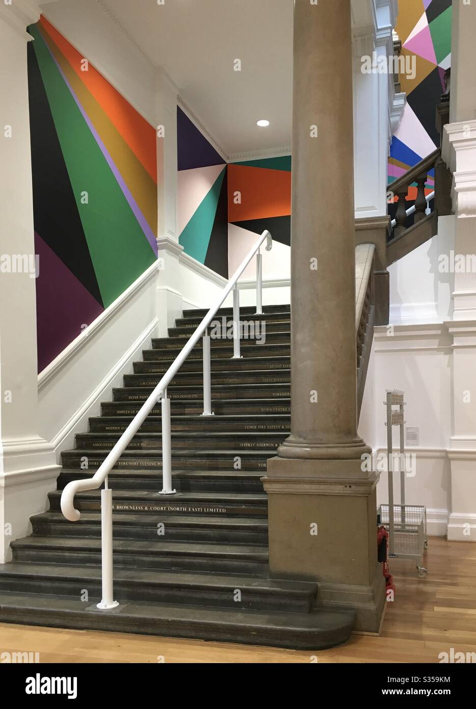 The colourful attractive decor of the main staircase in the entrance of Leeds City Art Gallery, West Yorkshire, UK. It is linked to the Henry Moore Institute with which it shares sculptures. Stock Photo