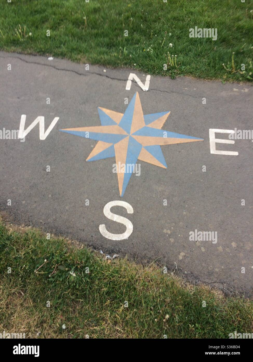 Compass points painted on footpath in play park in Stockton on Tees, England, UK Stock Photo