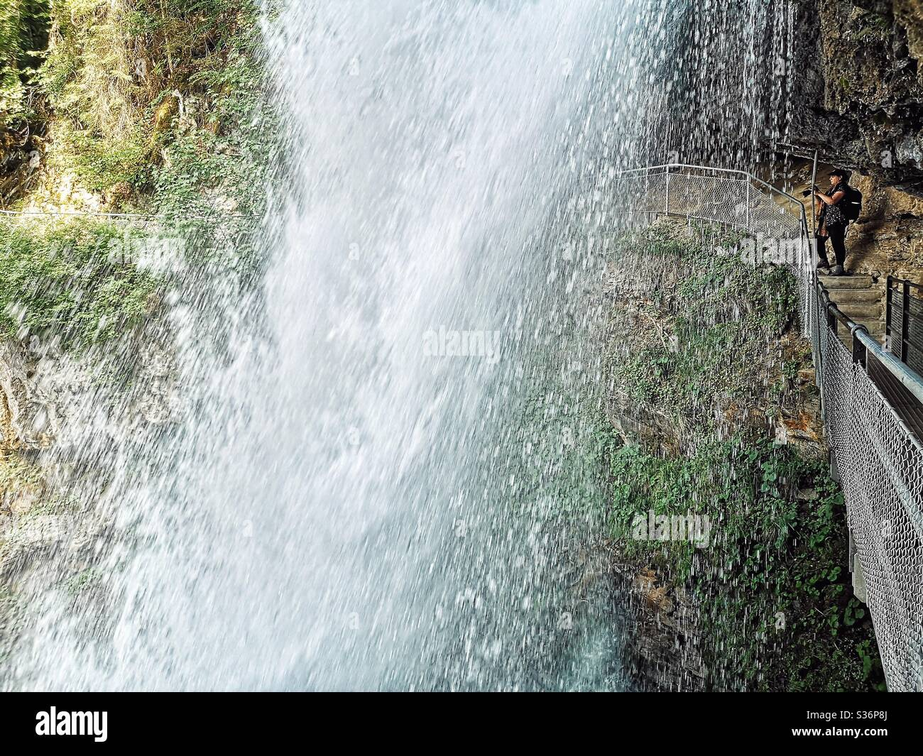 Photographer shooting the rushing waters of the Giessbach falls, Brienz, Switzerland Stock Photo