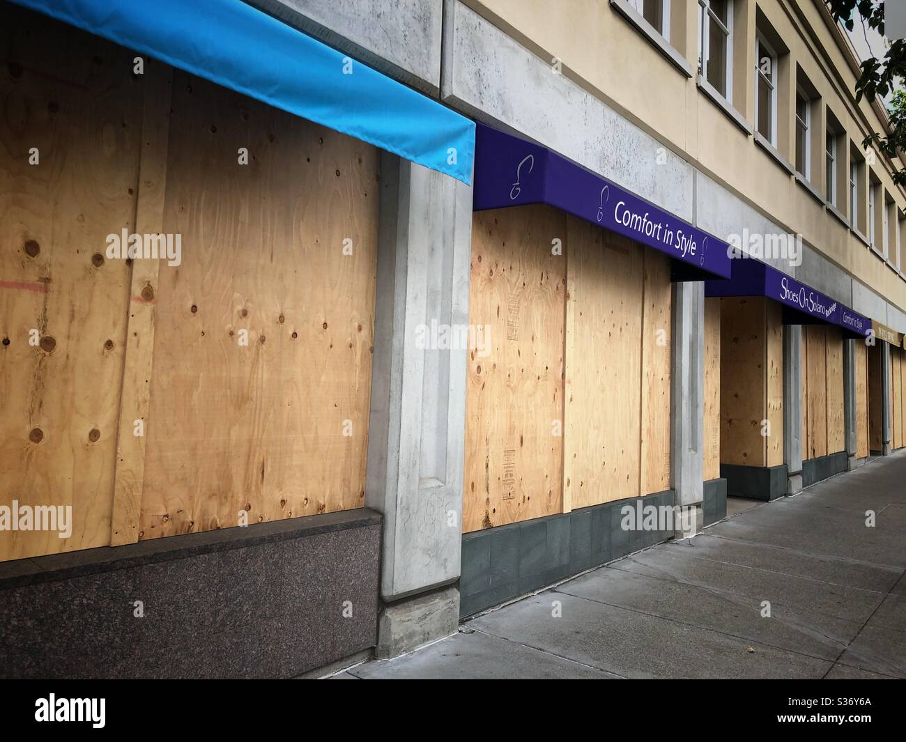 Boarded up storefronts on College Avenue in Oakland, California. Stock Photo