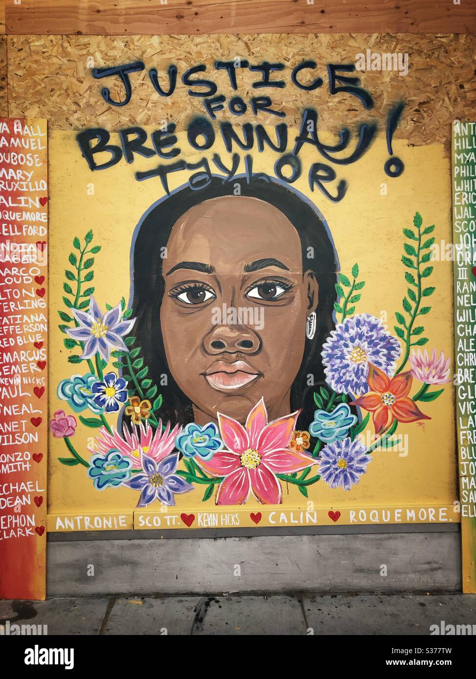 Justice for Breanna Taylor mural on a boarded up storefront in Oakland, California. Stock Photo