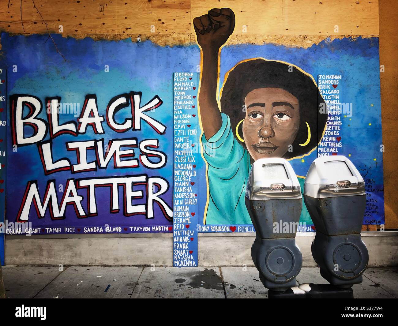 Black Lives Matter mural painted on a boarded up storefront in Oakland, California. Stock Photo