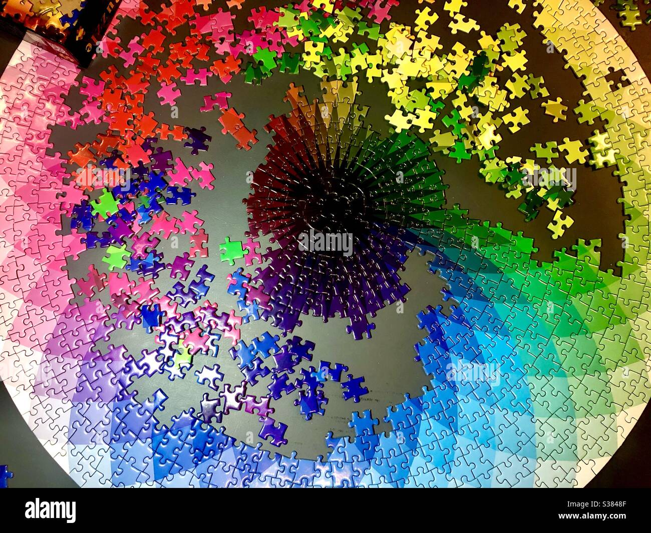 Completing a large jigsaw puzzle Stock Photo