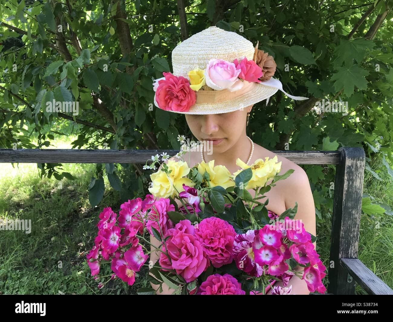 Young Girl with Flowers Stock Photo