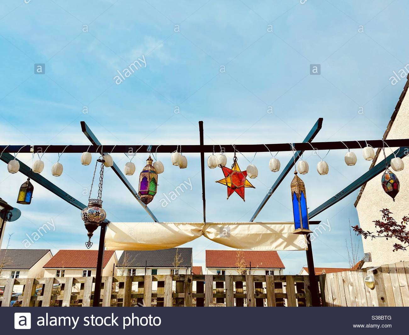 Colourful stained glass hanging lanterns in summer Stock Photo