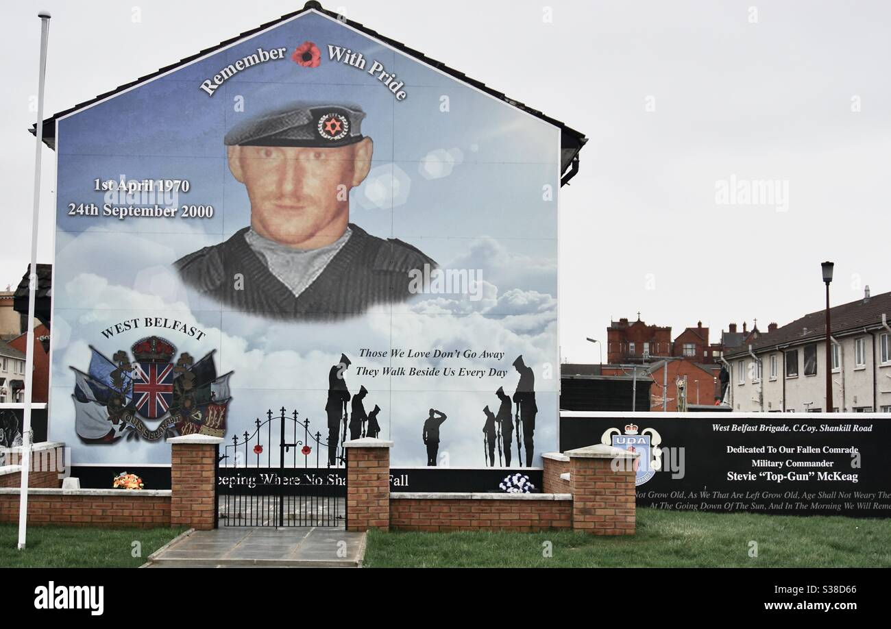 A Loyalist (Protestant) mural painted on a terrace house in the Shankill area of Belfast, Northern Ireland. These murals are famous symbols of the political and religious divides of the past. Stock Photo