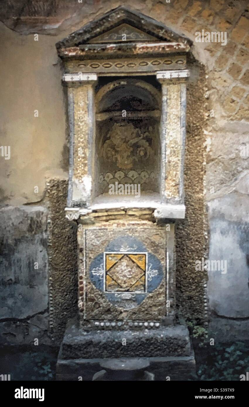 Small alcove in a wall in the ruins of Herculaneum, near Pompeii in Italy. Stock Photo