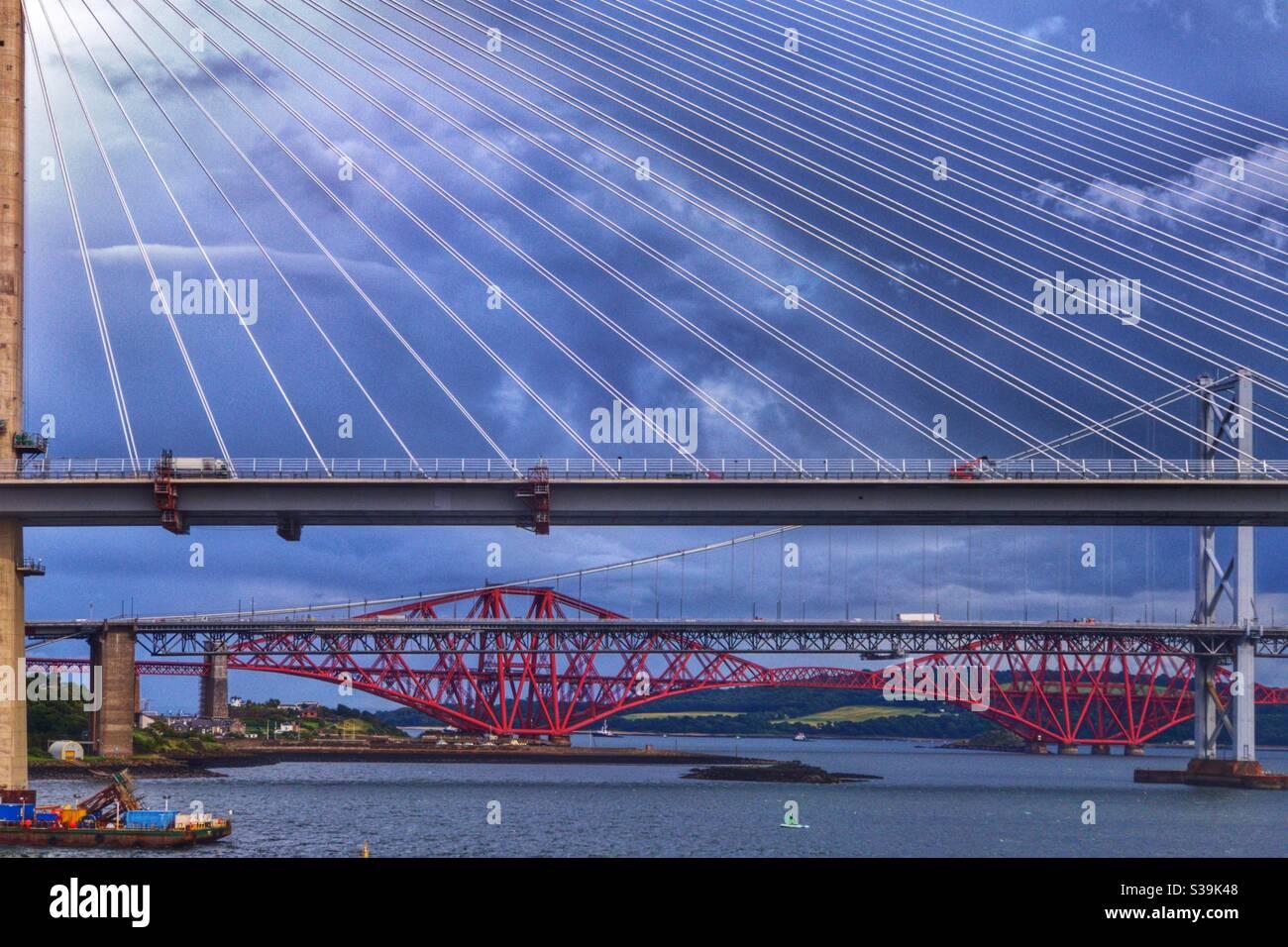 Queensferry crossing, Forth Road bridge and Forth bridge over the River Forth in Edinburgh, Scotland. Stock Photo