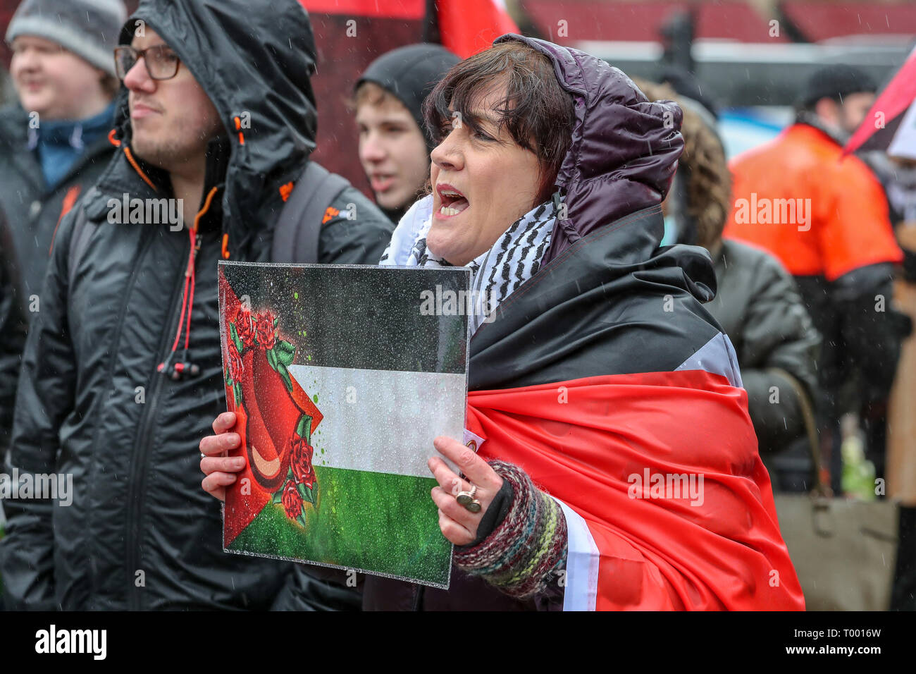 Glasgow, Scotland, UK. 16th Mar, 2019. Several hundred demonstrators turned up, despite the heavy rain, to take part in the Stand up to Racism March through Glasgow city centre as part of the worldwide 'Stand up to Racism' campaign. Several interest groups took part including Pro-Palestine and Anti-Semitic supporters requiring the substantial police presence to keep them apart although all were allowed to take part in the parade. Credit: Findlay/Alamy Live News - Stock Image