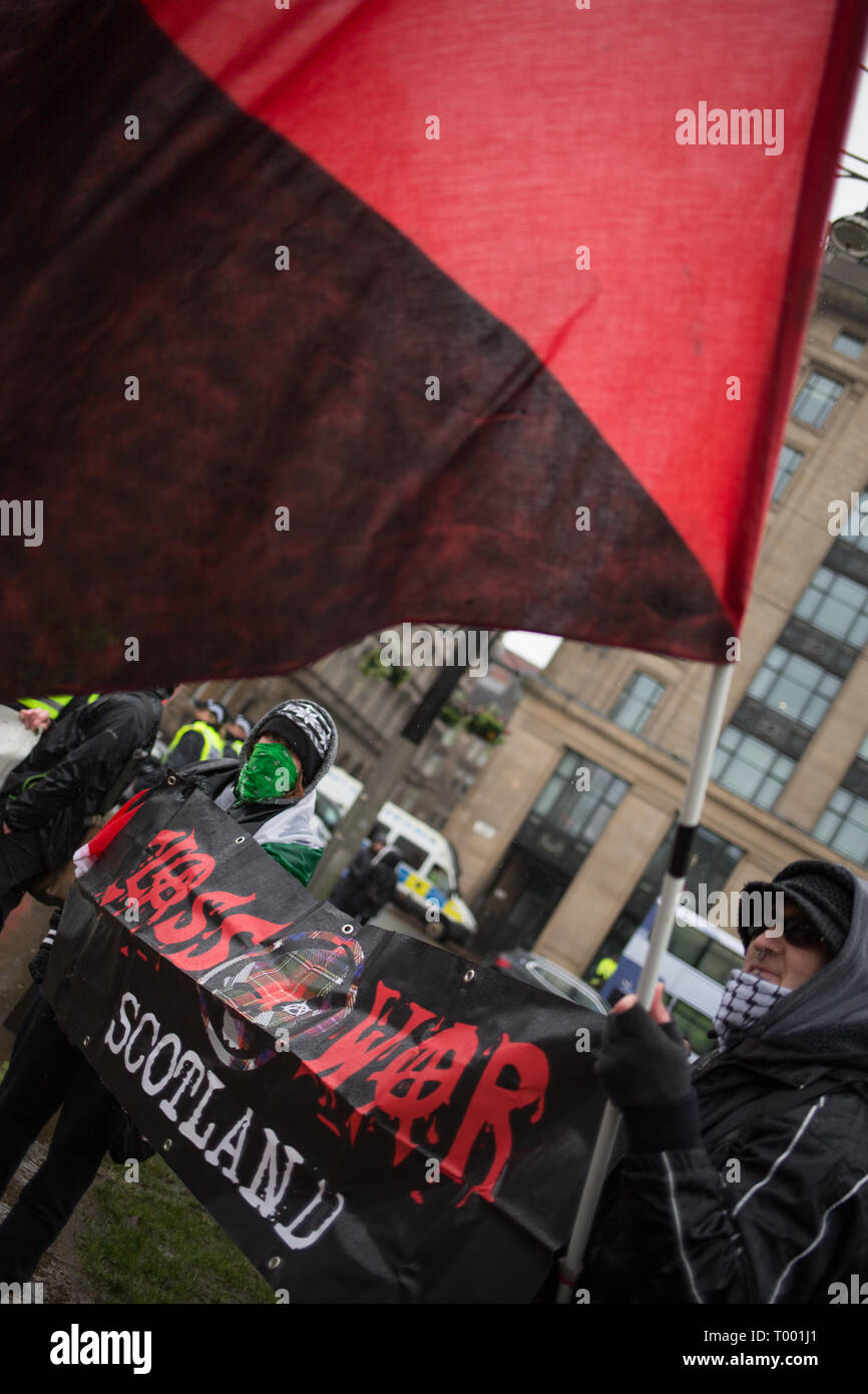 Glasgow, Scotland, 16th March 2019. Class War supporters at an Anti-racism rally in George Square, in Glasgow, Scotland, 16 March 2019.  Photo by: Jeremy Sutton-Hibbert/Alamy Live News. - Stock Image