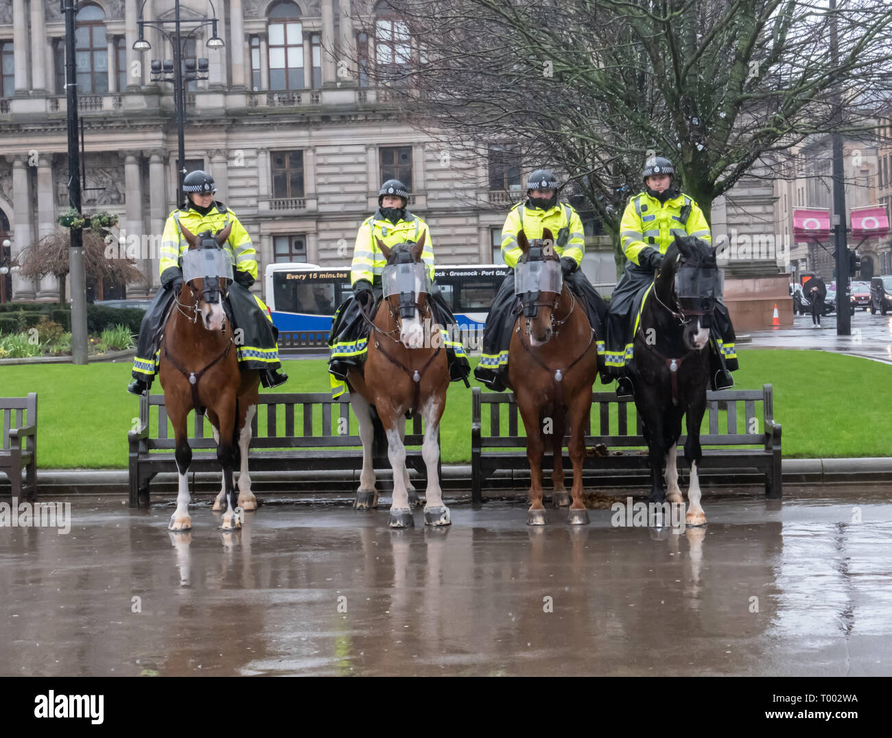 Glasgow, Scotland, UK. 15th March, 2019: Mounted officers from Police Scotland on duty in George Square during the Stand Up To Racism rally. Credit: Skully/Alamy Live News - Stock Image