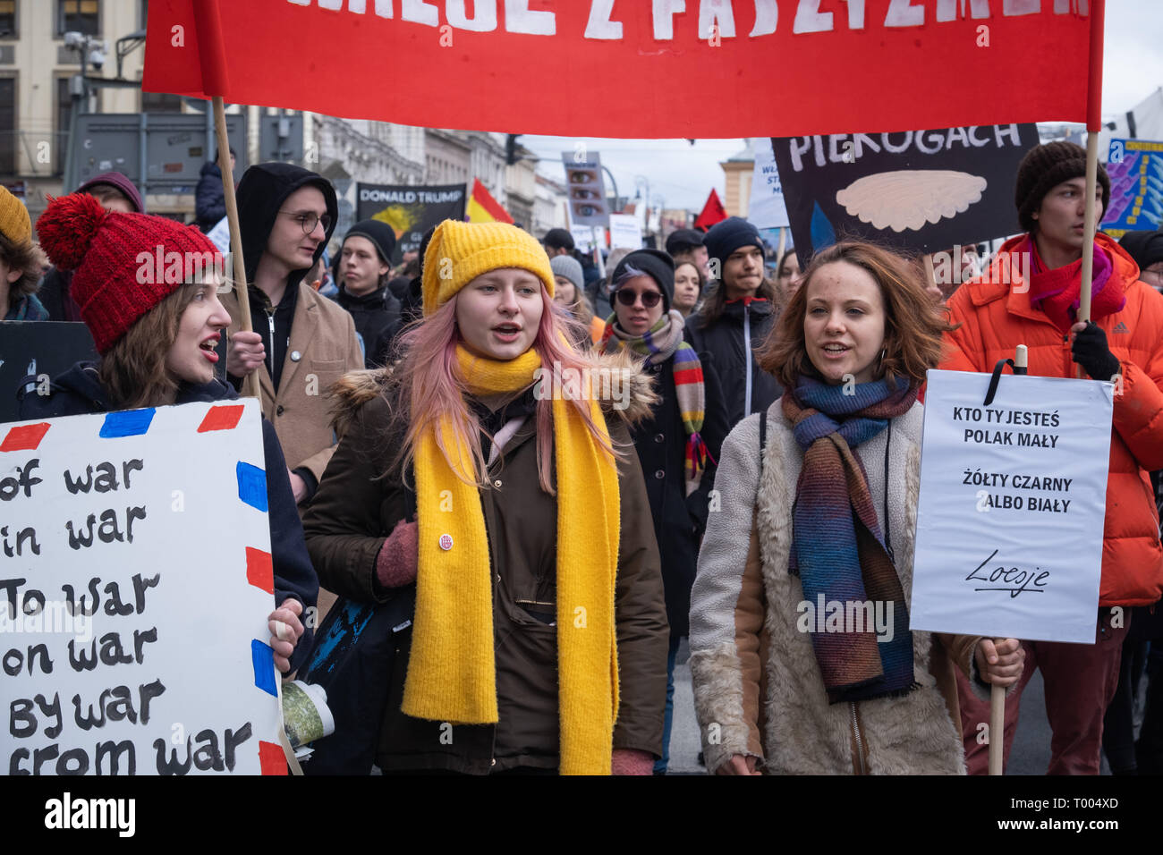 Warsaw, Poland. 16th March, 2019. Anti racist demonstration announced few weeks ago, due to tragic coincidence is also becoming a tribute to victims of terror attack in New Zealand. Antifascist and anti racist Polish organizations, collectives and NGO protest against any form of discrimination and growing wave and xenophobia and violence against immigrants. Robert Pastryk / Alamy Live News - Stock Image