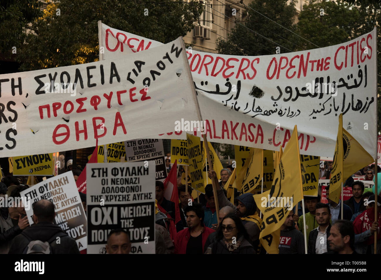 Athens, Greece. 16th March 2019. Migrants and refugees hold placards and shout slogans against racism and closed borders as well as against the greek neo-Nazi party Golden Dawn, currently on trial with accusations such as criminal organization, murder, possession of weapons and racist violence. Leftist and anti-racist organizations staged a rally on the occasion of the International Day against racism to demonstrate against discrimination and racist policies and behaviours. © Nikolas Georgiou / Alamy Live News Stock Photo