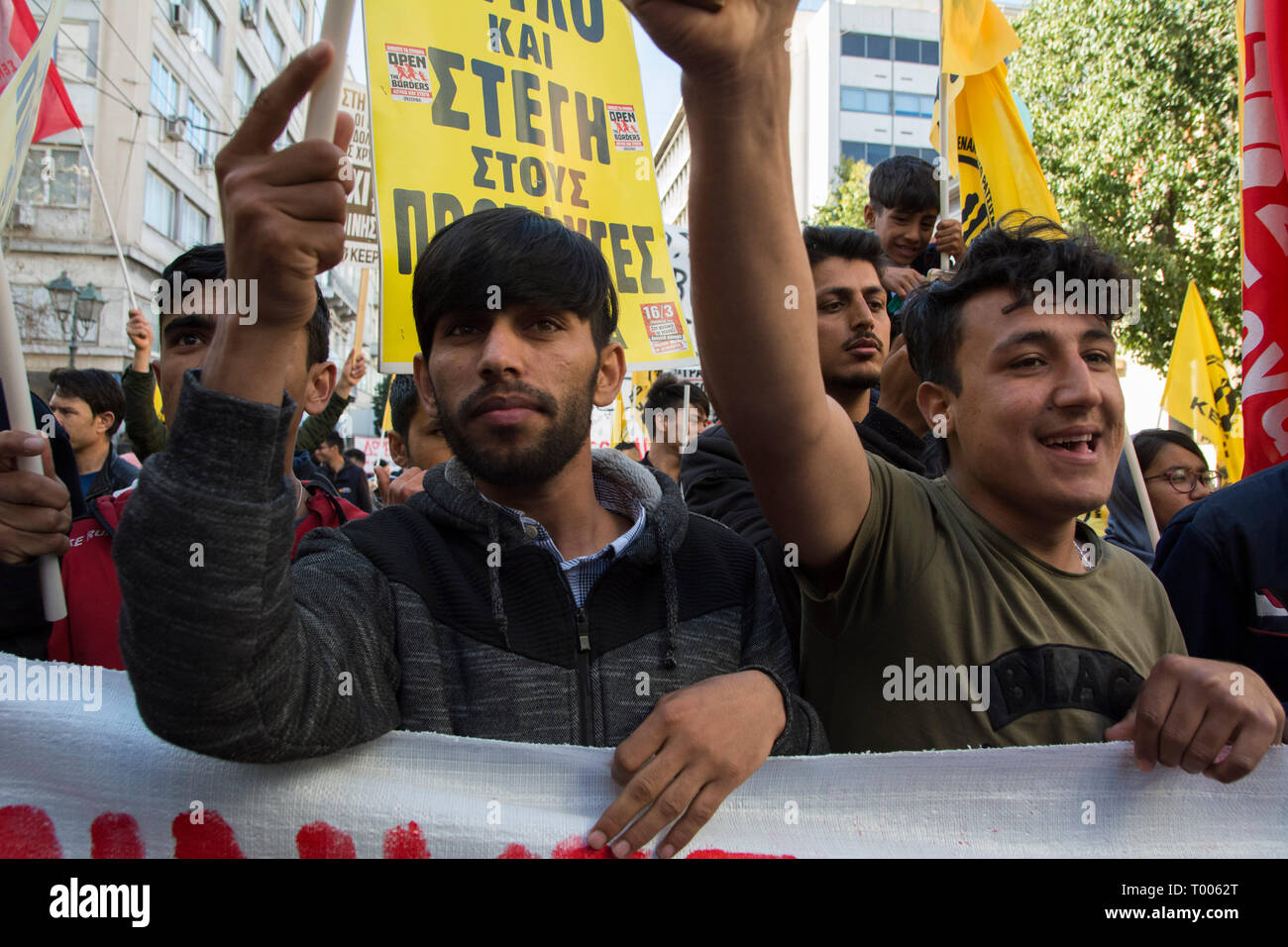 Athens, Greece. 16th March 2019. Migrants and refugees hold placards and shout slogans against racism and closed borders as well as against the greek neo-Nazi party Golden Dawn, currently on trial with accusations such as criminal organization, murder, possession of weapons and racist violence. Leftist and anti-racist organizations staged a rally on the occasion of the International Day against racism to demonstrate against discrimination and racist policies and behaviours. © Nikolas Georgiou / Alamy Live News - Stock Image