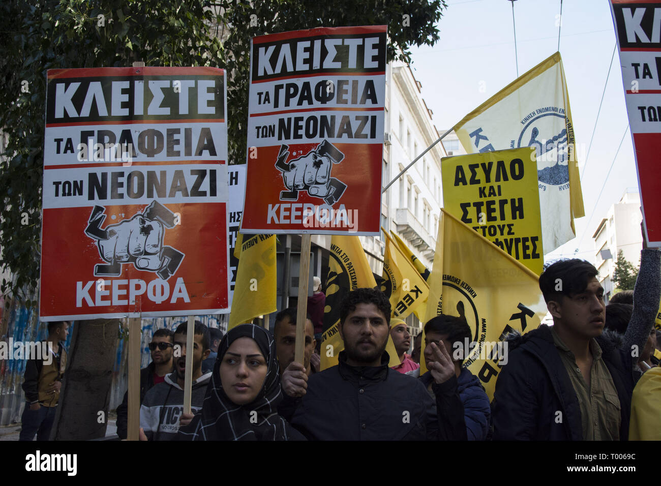 Athens, Greece. 16th Mar, 2019. Migrants and refugees hold placards and shout slogans against racism and closed borders as well as against the greek neo-Nazi party Golden Dawn, currently on trial with accusations such as criminal organization, murder, possession of weapons and racist violence. Leftist and anti-racist organizations staged a rally on the occasion of the International Day against racism to demonstrate against discrimination and racist policies and behaviours. Credit: Nikolas Georgiou/ZUMA Wire/Alamy Live News Stock Photo