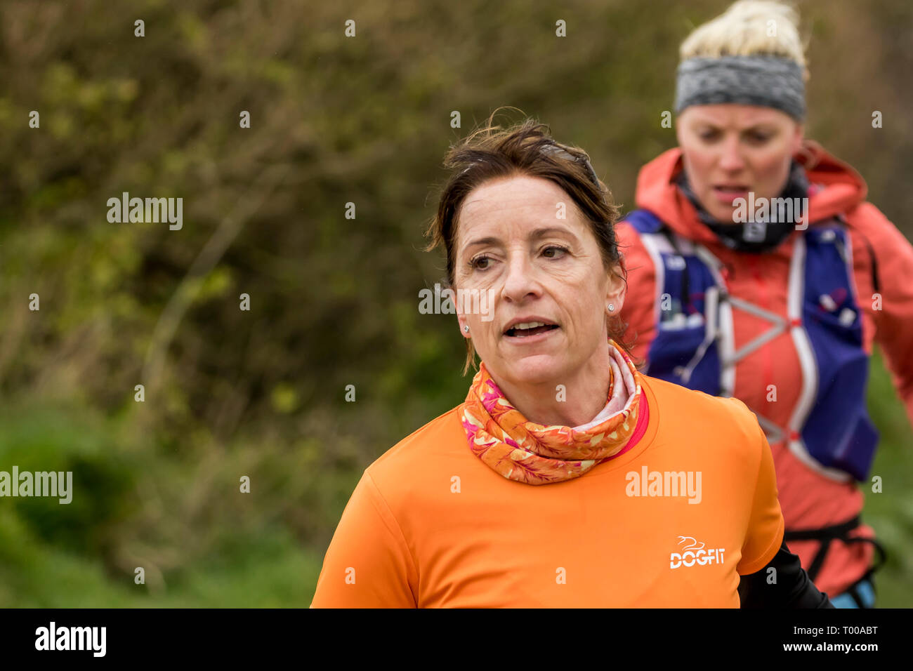 Birling Gap, East Sussex, UK. 16th March 2019. Despite strong winds and drizzle from Storm Gareth as it batters the UK, competitors at all levels face the exposed high cliffs of Beachy Head on the South coast of England to take part in a series of Endurance life race events. The 4 events consist of, a 10km, half and full marathon and for the most determined of runners the 34.1 mile Ultra event. The rough steep terrain represents one of the toughest marathon courses in the UK made all the more challenging in the fierce weather conditions. - Stock Image