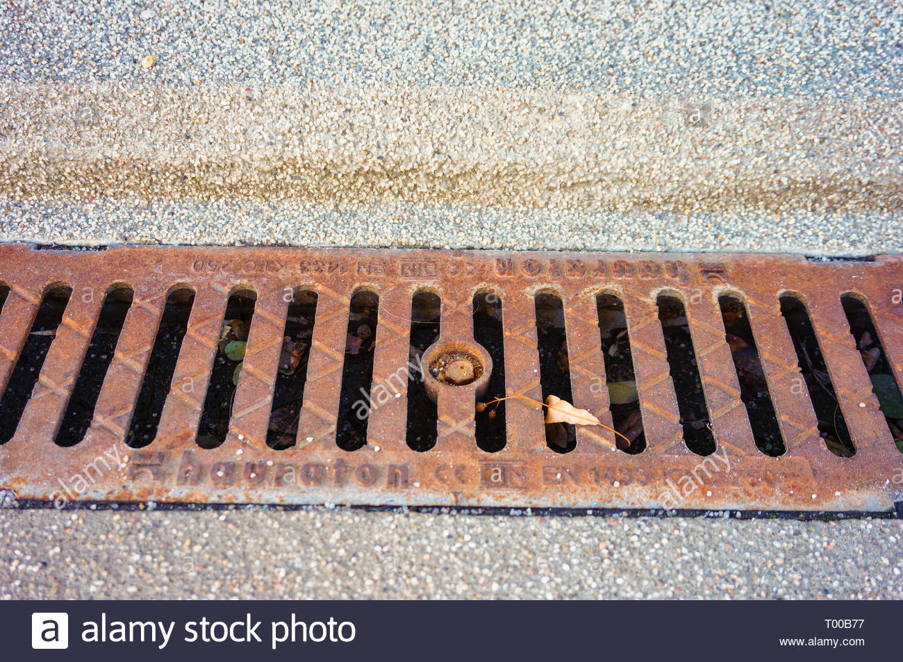 Poznan, Poland - October 31, 2018: Metal rain drain by a sidewalk in the city. Stock Photo