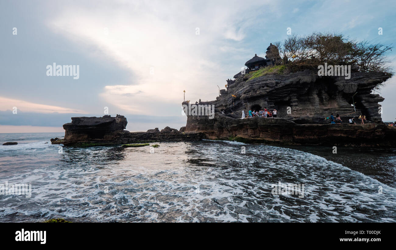 Bali, Indonesia - 11 Nov 2014: Tourists at Tanah Lot during low tide - Stock Image