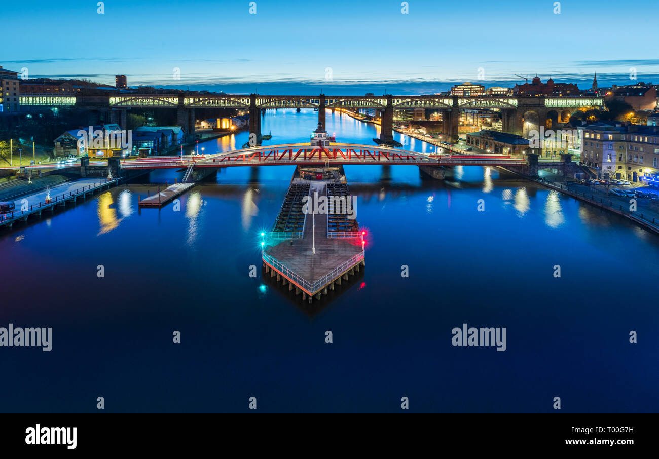 River Tyne between Newcastle Gateshead spanned by the Swingbridge Bridge showing the city lights at night. - Stock Image